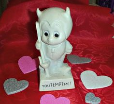 Check out this item in my Etsy shop https://www.etsy.com/ca/listing/506856677/70s-you-tempt-me-devil-statue-vintage