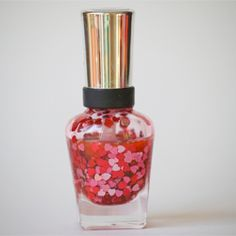 Make your own heart glitter nail polish.  Perfect for Valentines Day!