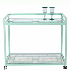 turquoise bar cart obsession! This could double as a console table with a lamp in a small apartment