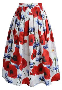 It's impossible NOT to stun in a skirt covered in calla lilies and pleats! With its fun blue and red floral print, this skirt is the perfect way to bring a little spring into the fall season.  - Side zip closure with hook - Inserted side pockets - Lined - 100% Polyester - Machine washable  Size(cm) Length Waist XS        72    64 S         72 &nb...