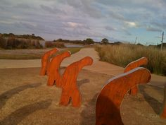 Wooden figures at sunset - Anglesea