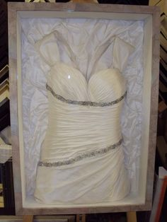 Frame your wedding dress. If you look closely, the back of the frame is the bottom part of the dress! Great for dressing room or walk in closet I've always wanted to do this!