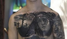 religious chest tattoo, black and grey