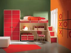 Red and orange inspired kids bedroom with cabinets, small study table and bed. #KBHome