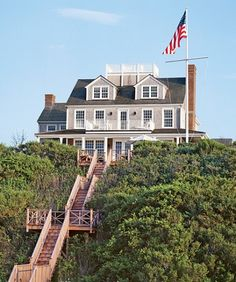 this is actually my dram, a house right on the beach with stairs leading up to the house right from the sand, so calm and relaxing, this house is gorgeous. I love the crow's nest at the top