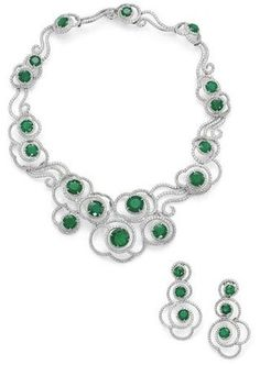 An emerald and diamond necklace and earring suite