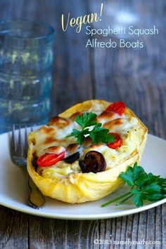 A perfect light and healthy summer dish, Spaghetti Squash Alfredo Boats...#vegan style!