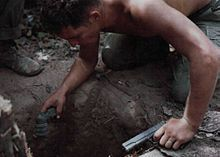 """American """"tunnel rat"""" prepares to enter a Viet Cong tunnel.  Vietnam War - Wikipedia, the free encyclopedia"""