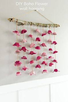 DIY Boho Flower Wall hanging craft idea. Cheap to make! All you need is 3 egg cartons and a stick!