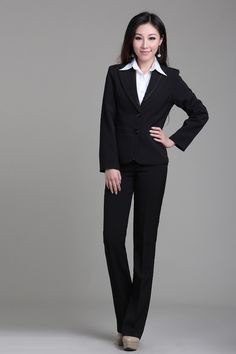 Crisp white shirt with a black suit worn beautifully by a woman with high contrast in her personal coloring.