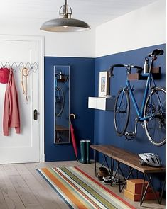 wheels up. A space saver for lofts, apartments and studios, clever rack stores your bike off the floor and out of the way. Handcrafted of solid sustainable plantation-grown shesham wood, rack is notched to hook onto your crossbar. Varying wood grain and tones make each unique. Mounts easily to the wall with included hardware.