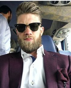 Half-Slicked Back Blonde Hair with Ponytail and Undercut Sides Stylish Haircuts, Cool Haircuts, Haircuts For Men, Bryce Harper Haircut, Low Skin Fade Haircut, Long Slicked Back Hair, Handsome Bearded Men, Mohawk Styles, Thick Beard