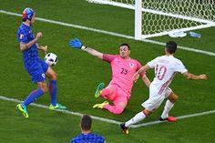 Cesc Fabregas passes the ball past Croatia's goalkeeper Danijel Subasic and Vedran Corlukato set up Alvaro Morata.