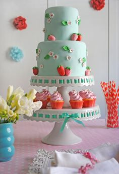 Let Me Eat Cake adore the strawberry theme with the strawberries and the blossoms and bottom tier of cupcakes. TOO cute. Love the color and the ribbons strung through stand.
