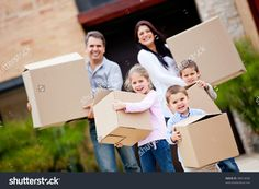 Happy family moving house and carrying boxes