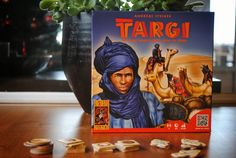 Targi is a two player game in which players assume the role of leaders of two Tuareg tribes who want their tribe to gain as much prestige and wealth as possible. The goal: make it to the end of the game while handling your tribes and your trades to gain the most victory points.The game is played on a grid of 25 cards, which symbolize the goods of the tribes. There is a fixed number of cards of 16 before you reach the edge of the desert.