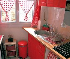 Size isn't everything! I love this dinky little kitchen. Although it's not huge, it's cleverly organised & utterly charming! Kitchen Dining, Kitchen Decor, Kitchen Cabinets, Kitchen Ideas, White Kitchen Curtains, Red Dinnerware, Kitchen Trash Cans, Chicken Kitchen, Kitchen Must Haves