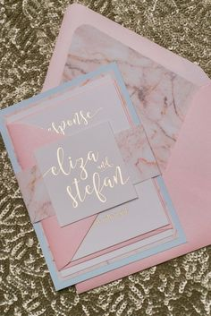 What is not to love with these blush marbled invitations with gold writing?
