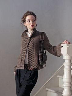 Cora. Like shape of collar and body but will adapt sleeves and cable design.