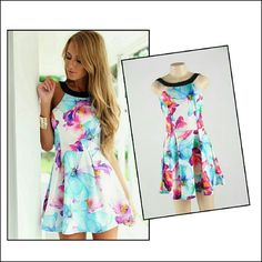 *NWOT* Halter Dress Adorable multi color halter neck floral flare dress. Size L, runs a bit small. Dresses