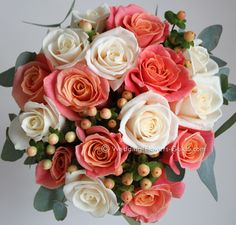 Miss Piggy peach roses and Vendela cream roses with peach hypericum berries