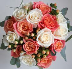 Miss Piggy peach roses and Vendela cream roses with peach hypericum berries