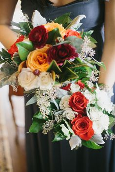 (Two full bouquets for a colorful wedding. I like the top one better, since it has magnolia-like leaves in it...