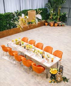 orange reception chairs, citrus zest yellow contemporary tablescape