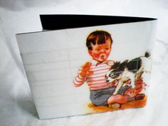 Back of wallet #2 Bifold made from paper and packing tape. Each is unique with illustrations from children's books. Very slim and durable. 1 bill pocket 1 card slot 1 ID window $8