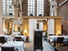 Architects Freyke Hartemink and Jarrik Ouburg insert a restaurant in Amsterdam's oldest chapel - News - Frameweb
