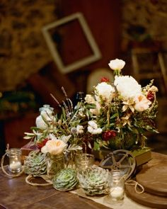 Other groupings of succulents and roses were scattered among old film reels and candles, many of which now populated the pair's home.