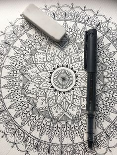 Hand drawn mandala pattern using compasses, pencil, protractor, rubber and pilot V5 Hi Tecpoint pen