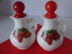Vintage Set of Avon Strawberries and Cream Cruets.  Pretty crisp set of Avon cruets featuring strawberries! This pretty pair has slightly two different shades of red stoppers, perfect way to indicate