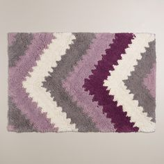 With pops of plum, lavender and frost gray in a chevron design, our exclusive bath mat gives your bathroom decor a modern feel.