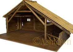 Kst-25 Kerststal met een dak van riet