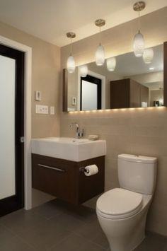 Custom vanity based on Duravit design. Toto Aquia toilet for hall and master.