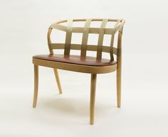 The webbing of this seat, in natural tan leather or linen, is part of its instant appeal and intrigue. Its low resting back and angled legs give it a soft alluring curve. Created for Gemla, by Swedish design group Front, the Collage chair is crafted from beech.