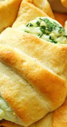 Cheesy Spinach Crescents ~ Light & fluffy crescent rolls loaded with melted cheese & spinach are easy & delicious!