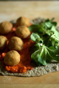 vegan homemade piadina made with hemp flour, filled with ajvar and millet balls