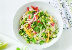 The tangy coconut lime dressing in this cool and colorful rice noodle salad by Clean Eating goes hand in hand with naturally sweet mango and red bell pepper. We recommend making ahead of time and a...