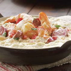 An amazing shrimp and grits recipe that gets even more amazing with the addition of bacon.  (Don't judge me).