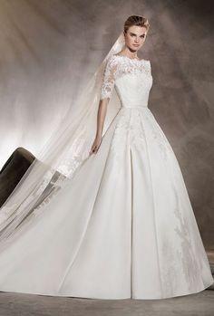 Romantic modest quarter length sleeve ballgown wedding dress; Featured Dress: Pronovias