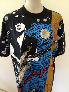 My dad took the photo, that they used on this concert t-shirt, for Stevie Ray Vaughan. You can even see his own name printed on it, for a photo credit.
