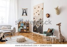 Stock Photo: Stylish scandinavian interior design of childroom with gray sofa, modern climbing wall for kids, design furnitures, soft toys, teddy bear and cute children's accessories. Home decor. Kids Art Space, Climbing Wall Kids, Scandinavian Interior Design, Gray Sofa, Nursery Neutral, Nursery Themes, Room Interior, Decoration, The Help