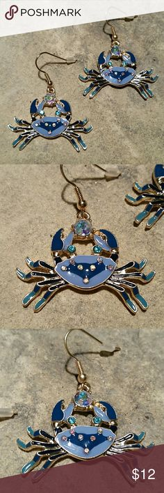"Betsey Johnson Blue Crab Ocean Dangle Earrings New without tags, never worn, Betsey Johnson enamel blue beach crab dangle earrings. Periwinkle, teal, and deep ocean blues are enameled over shiny gold tone metal, Carribean Sea blue crystal rhinestone eyes, aurora borealis (rainbow sheen) crystals on their backs and clutched in their claws. French hook ear wires. Measure 1.5"" across, hang 1"" from hook.  Thank you for visiting my closet, and happy poshing! :)  SORRY, NO TRADES  BUNDLE & SAVE…"