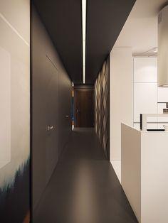 Ingresso e corridoio casa moderna con muro originale e grande quadro moderno.