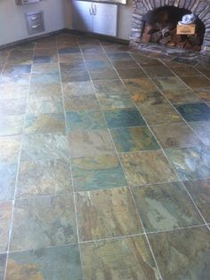 Cleaning and sealing slate tile floors- I hate my kitchen floors with passion. Would possibly be better if the floor was smooth and not raised. Lesson: not all 19 years are prep to be homeowners