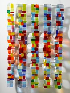 fused glass - love the colorful reflections on the wall