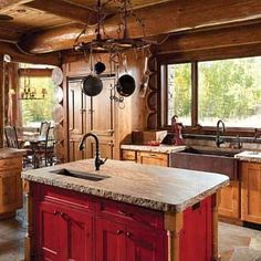Handcrafted Log Cabin Kitchen in rustic red!