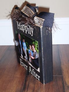 "Photo Block Picture Clip in Black Weathered / Distressed Wood - Tan Vinyl Words ""Happily Ever After"", Black & Gold Glitter Ribbon 4 x 6 Size. $18.00, via Etsy."